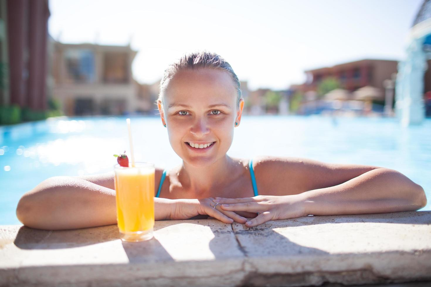 Woman with a drink at a pool photo