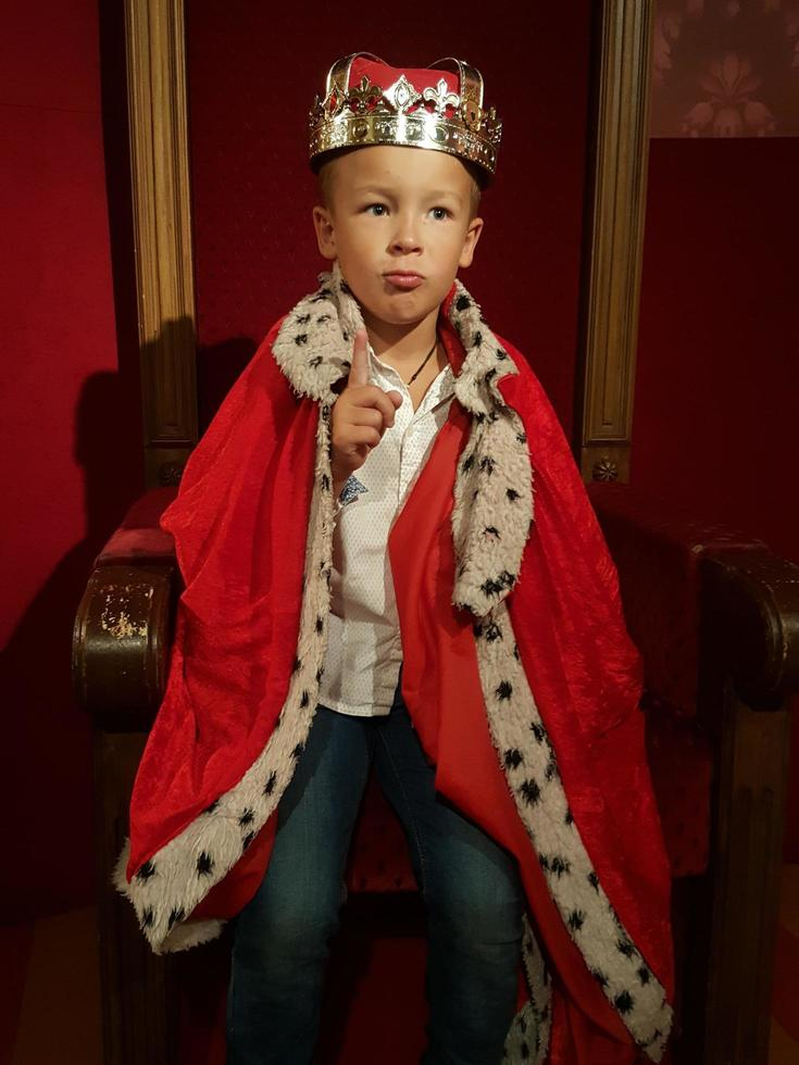 Boy dressed as a king photo
