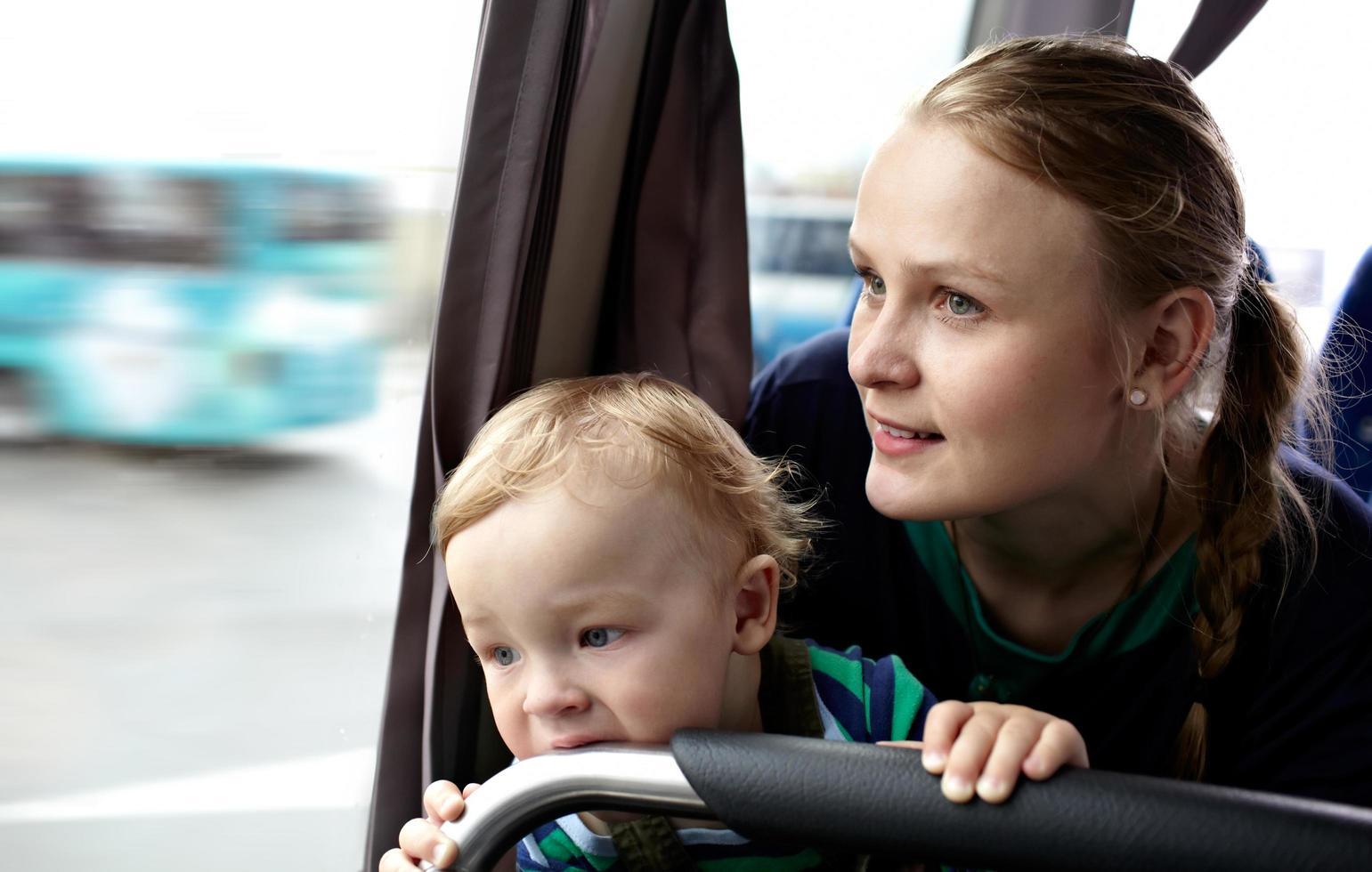 Mother and son on a bus photo
