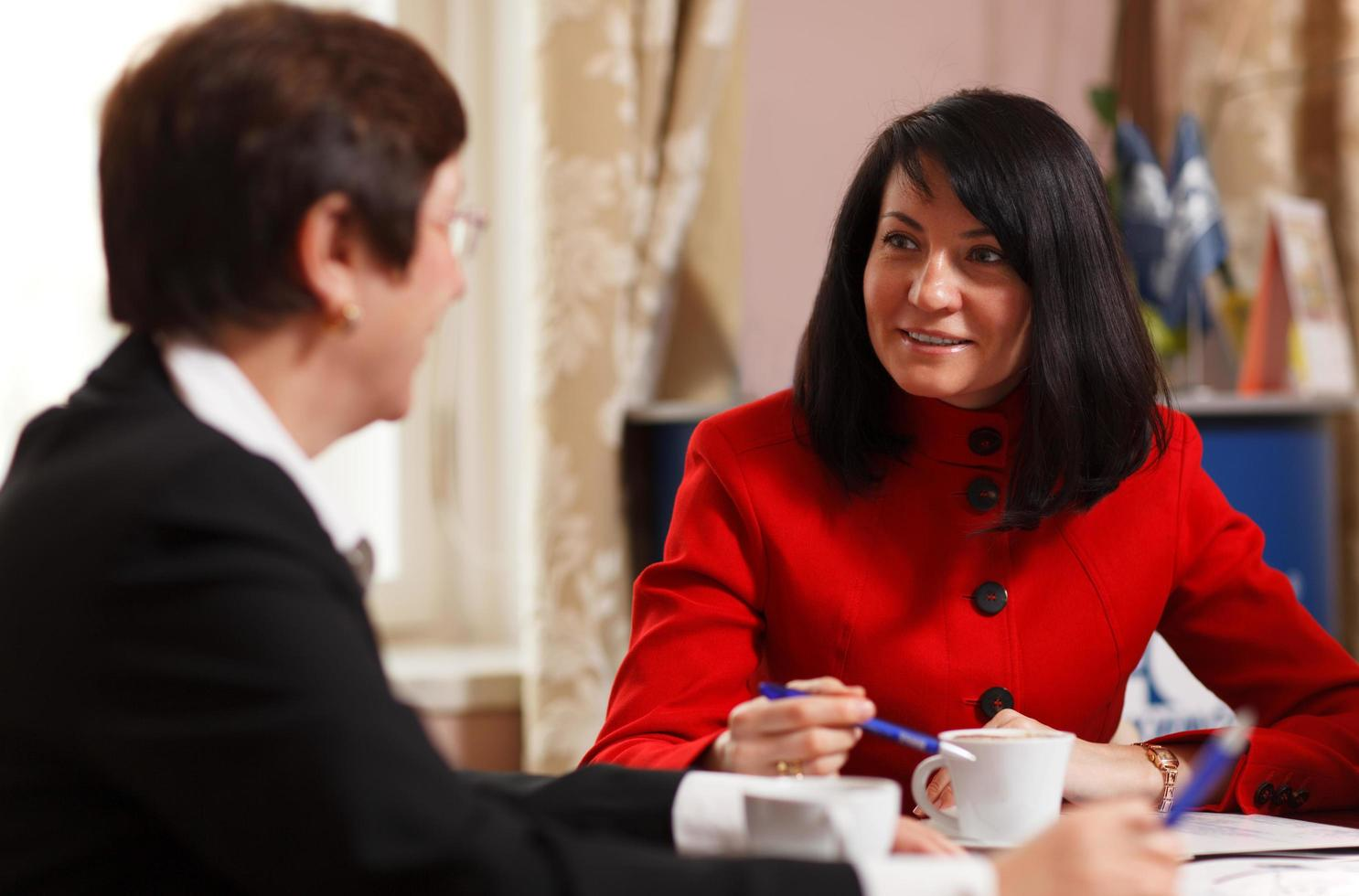 Two businesswomen in a meeting photo