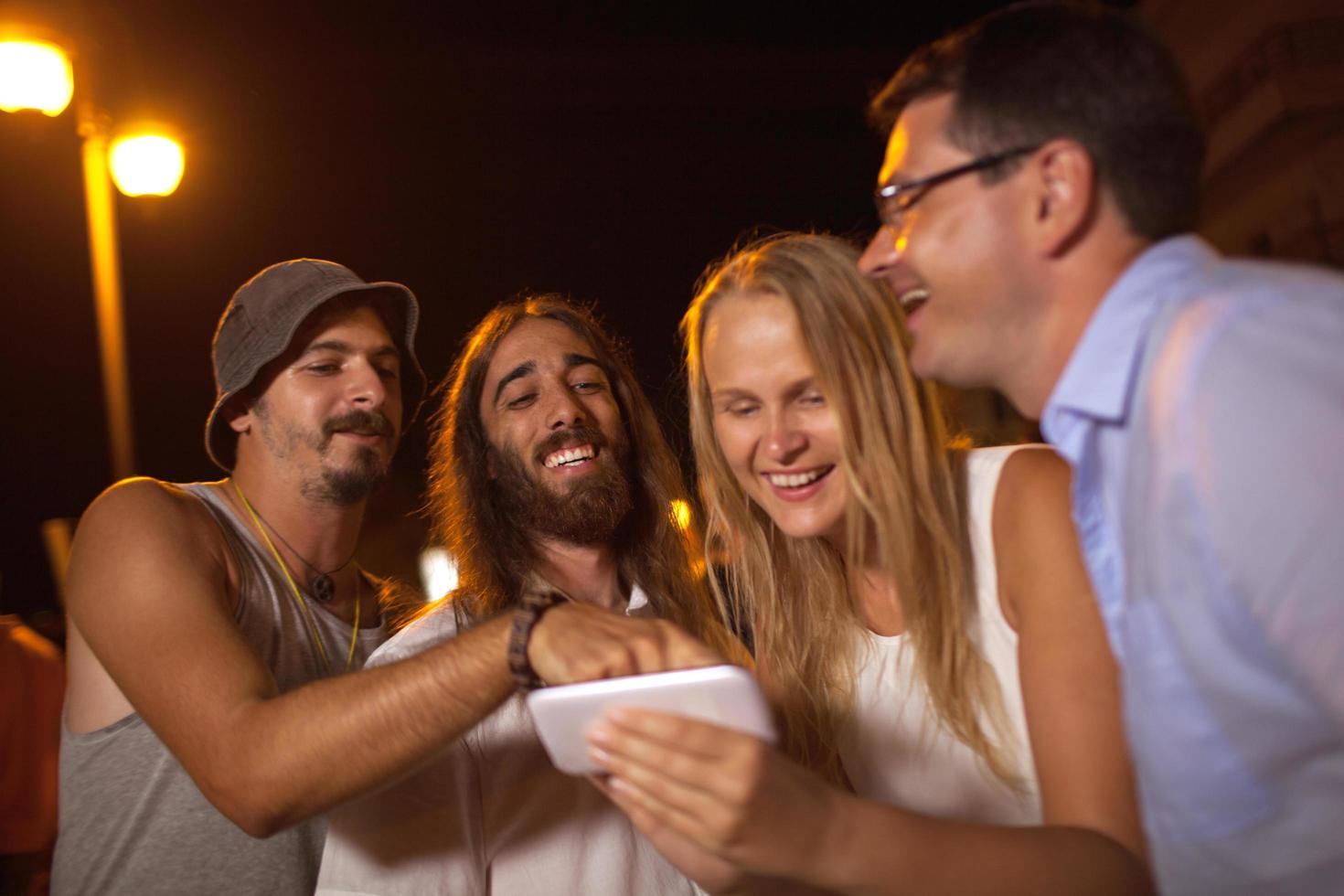 Friends having fun looking at a phone photo