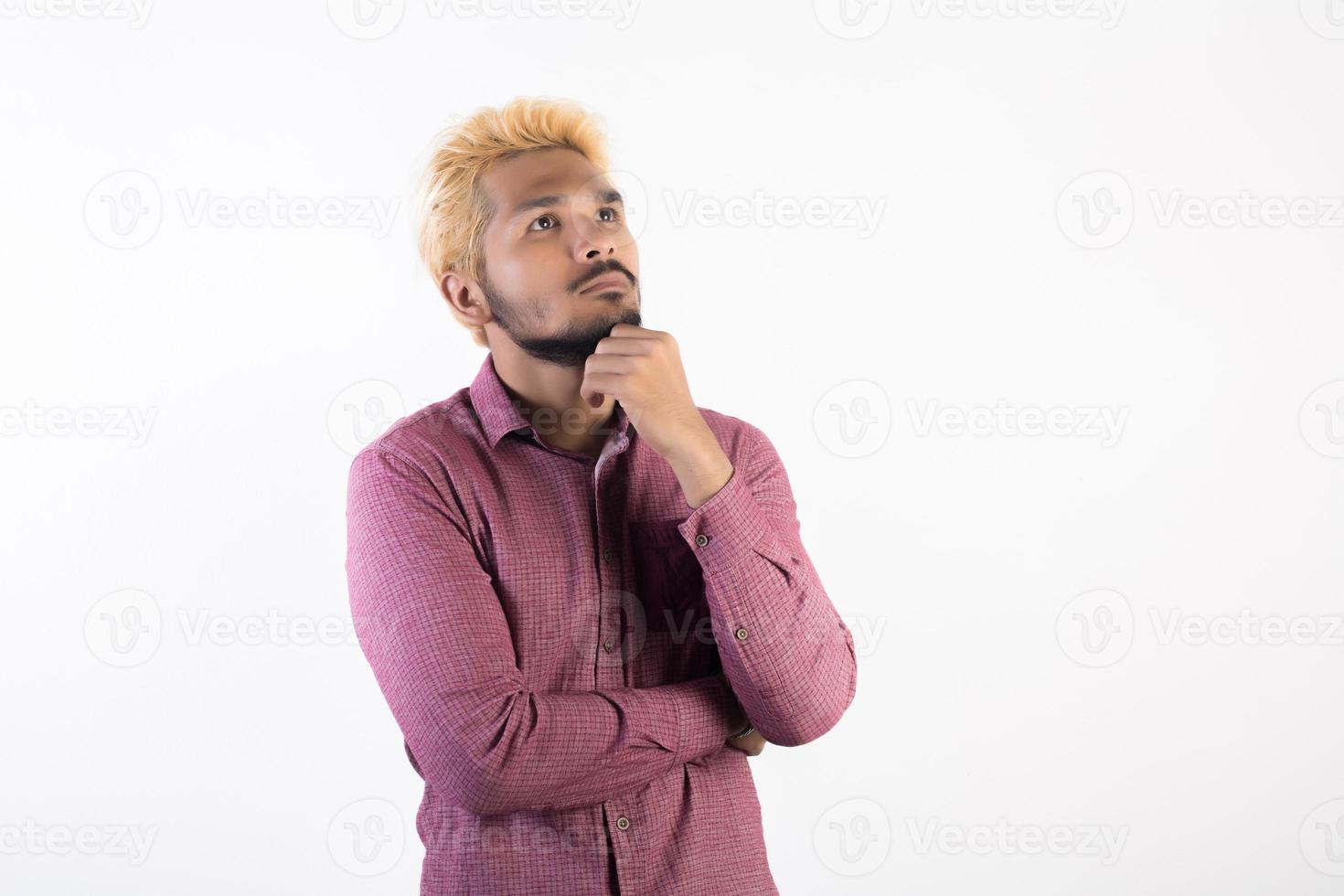 Portrait of a handsome hipster man standing isolated on white background photo