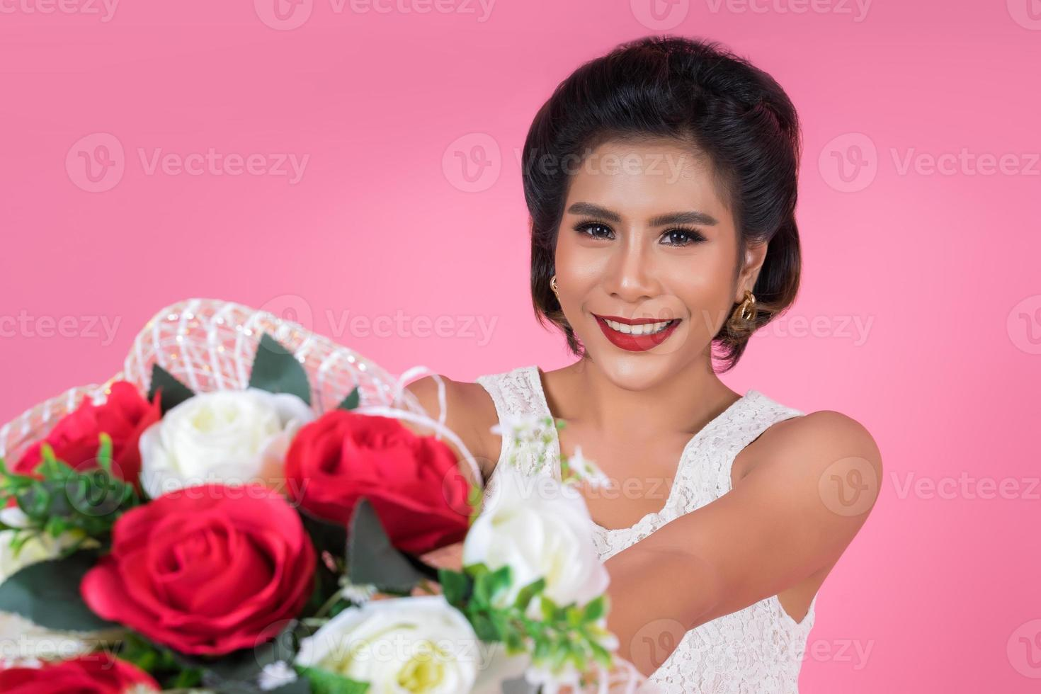 Portrait of a beautiful woman with bouquet of flowers photo