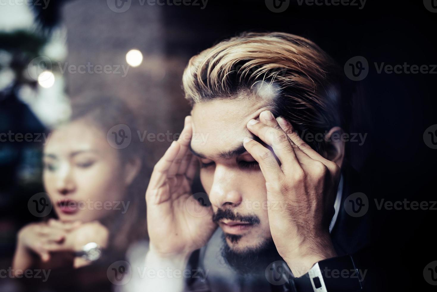 Businessman thinking about a problem at a cafe photo