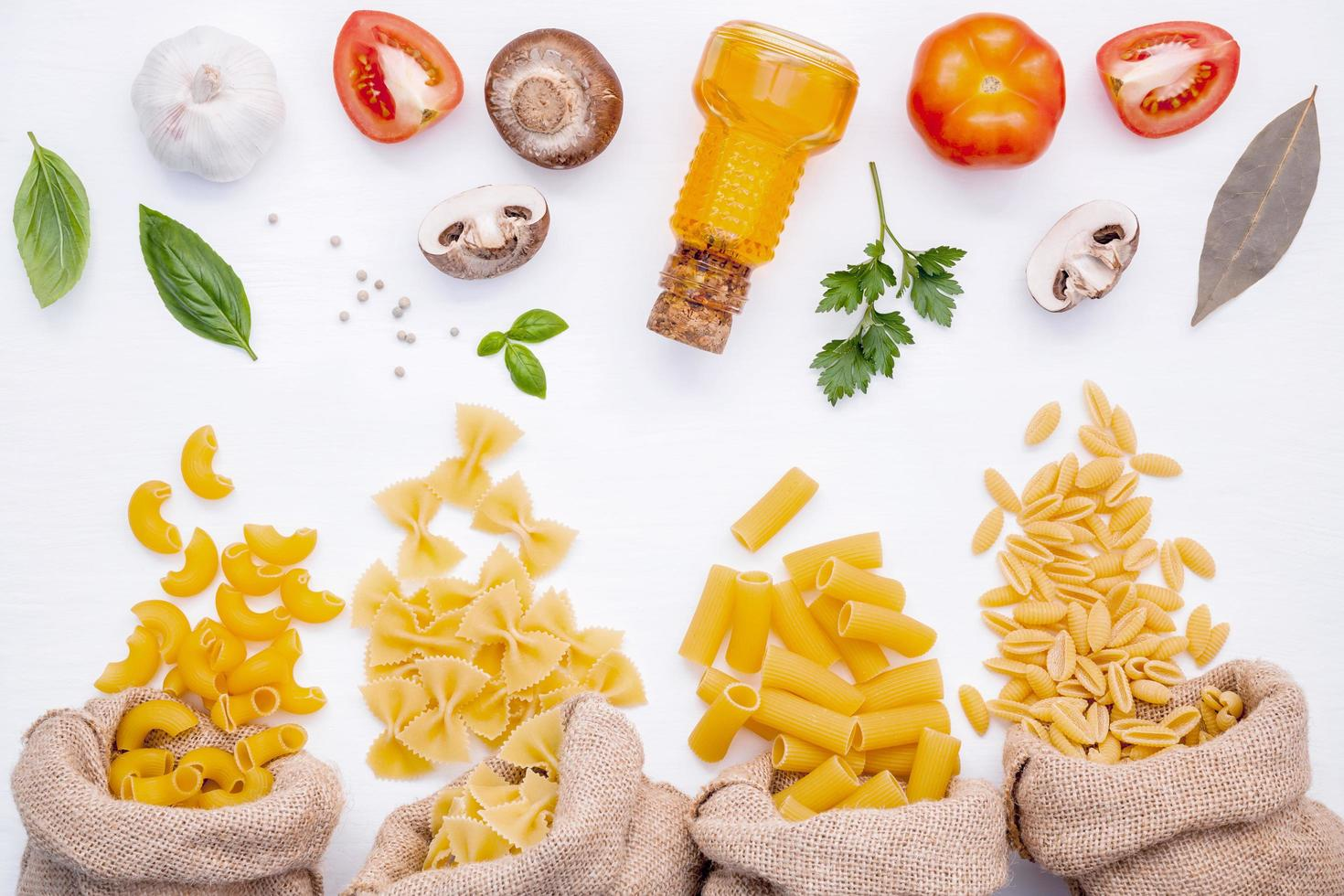 Assorted pasta and cooking ingredients photo