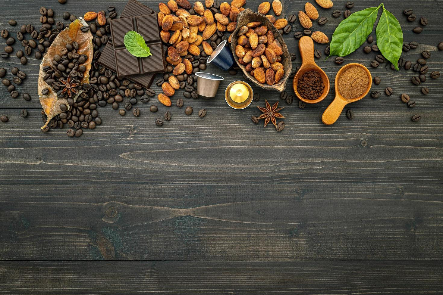 Coffee and chocolate with spices on a dark wooden background photo