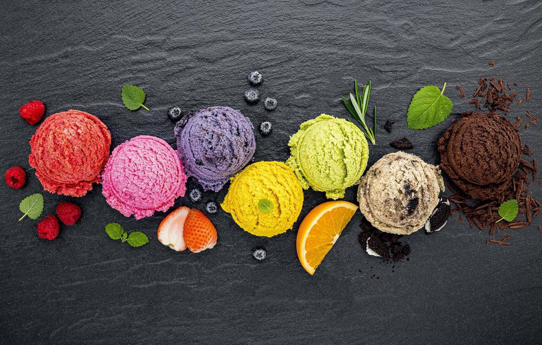 Ice cream and fruit on slate photo