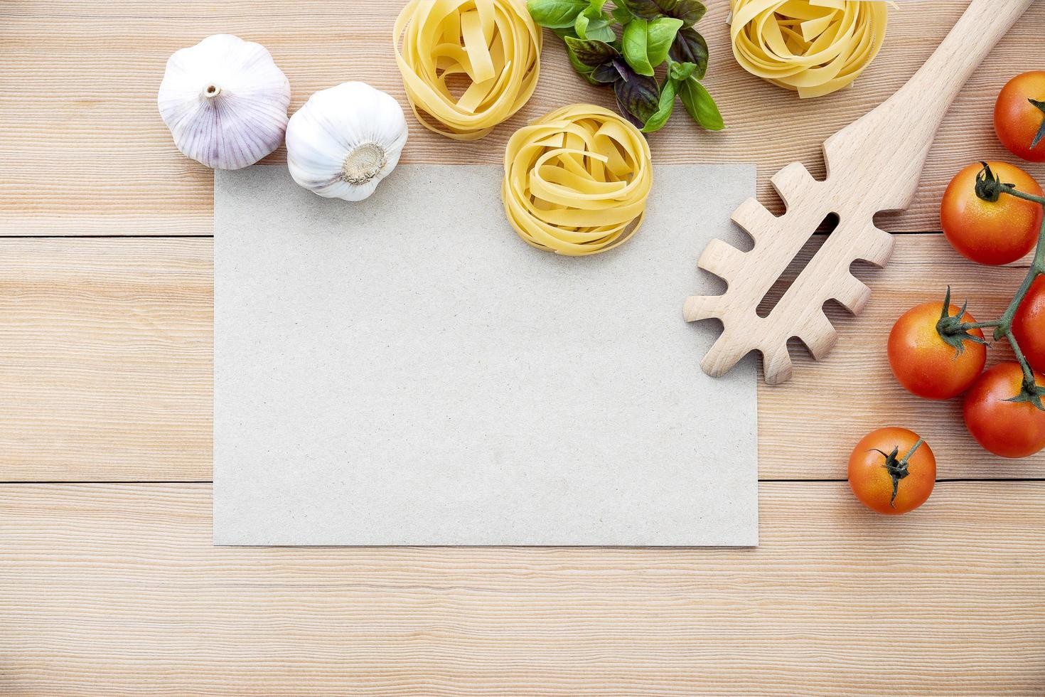 Pasta ingredients with a blank page photo