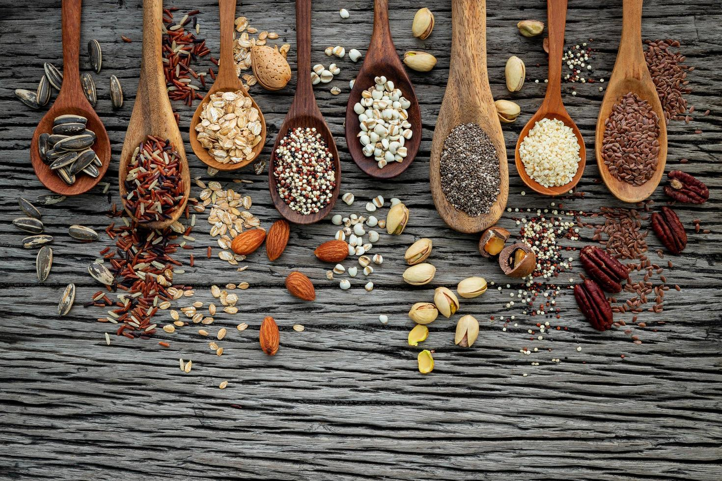 Grains on wooden spoons photo