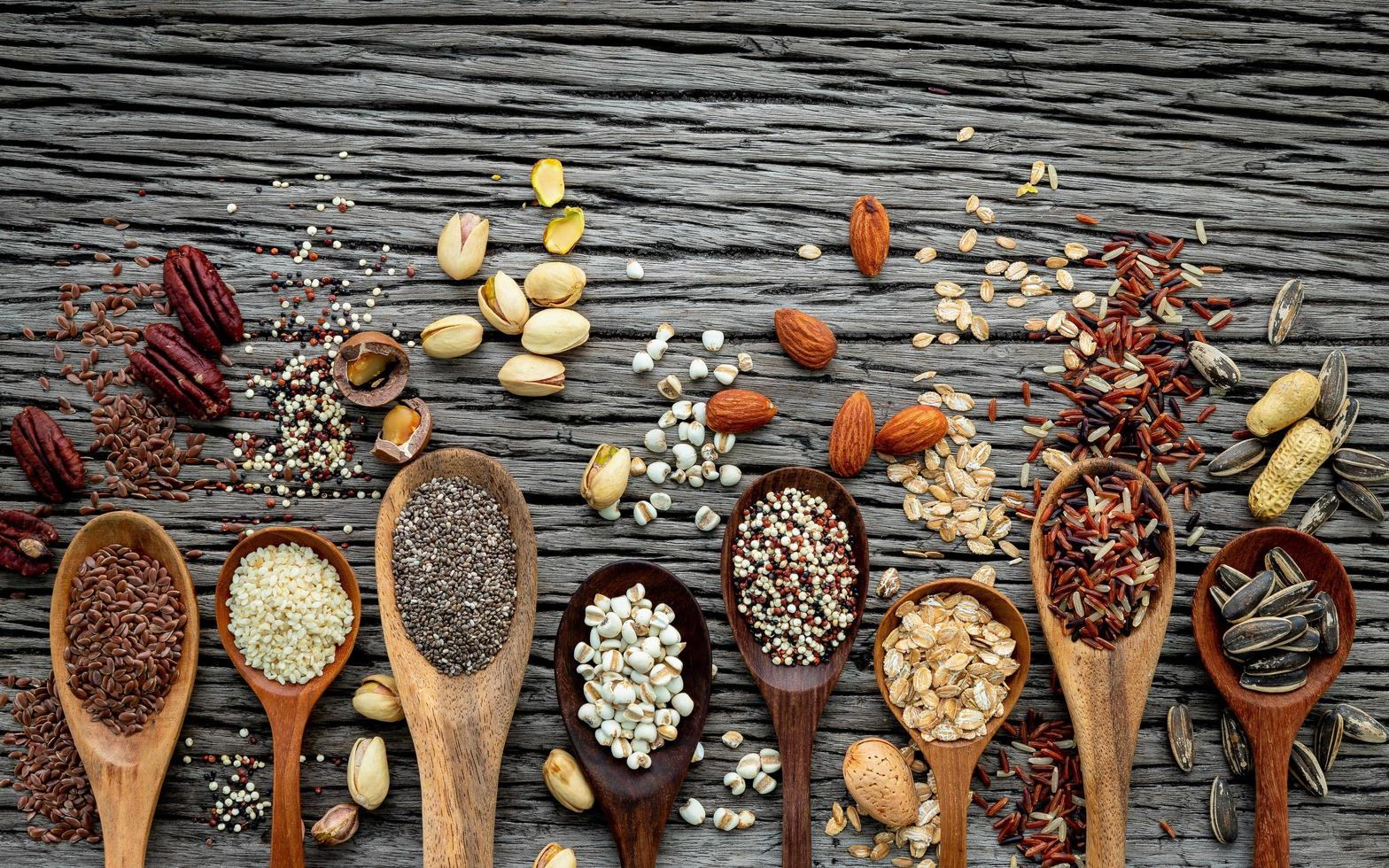 Grains in wooden spoons photo