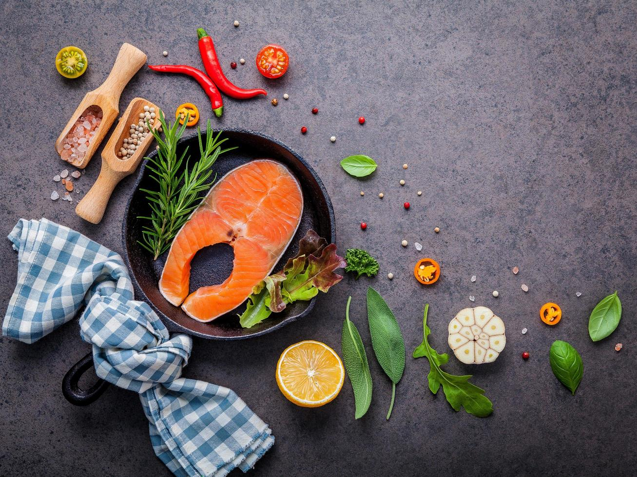 Raw salmon fillet with fresh herbs and spices photo