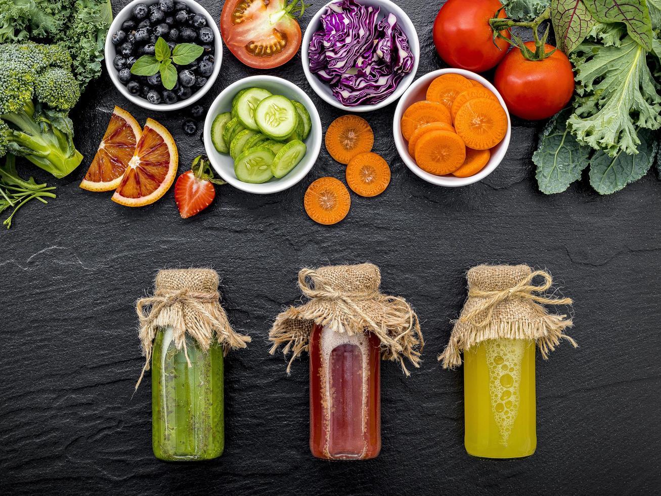 Fruit and veggies with juice photo