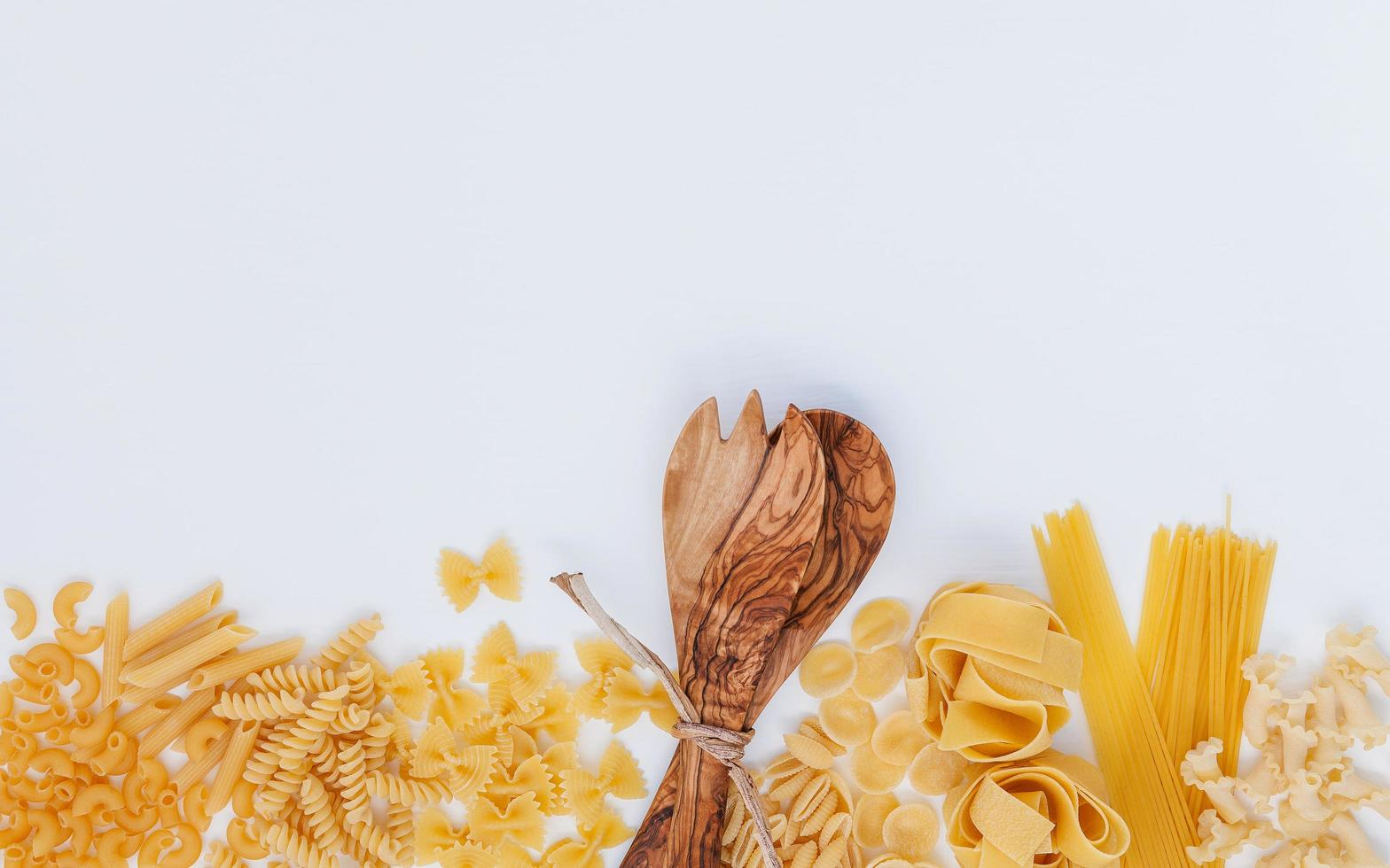 Pasta and a wooden utensil photo