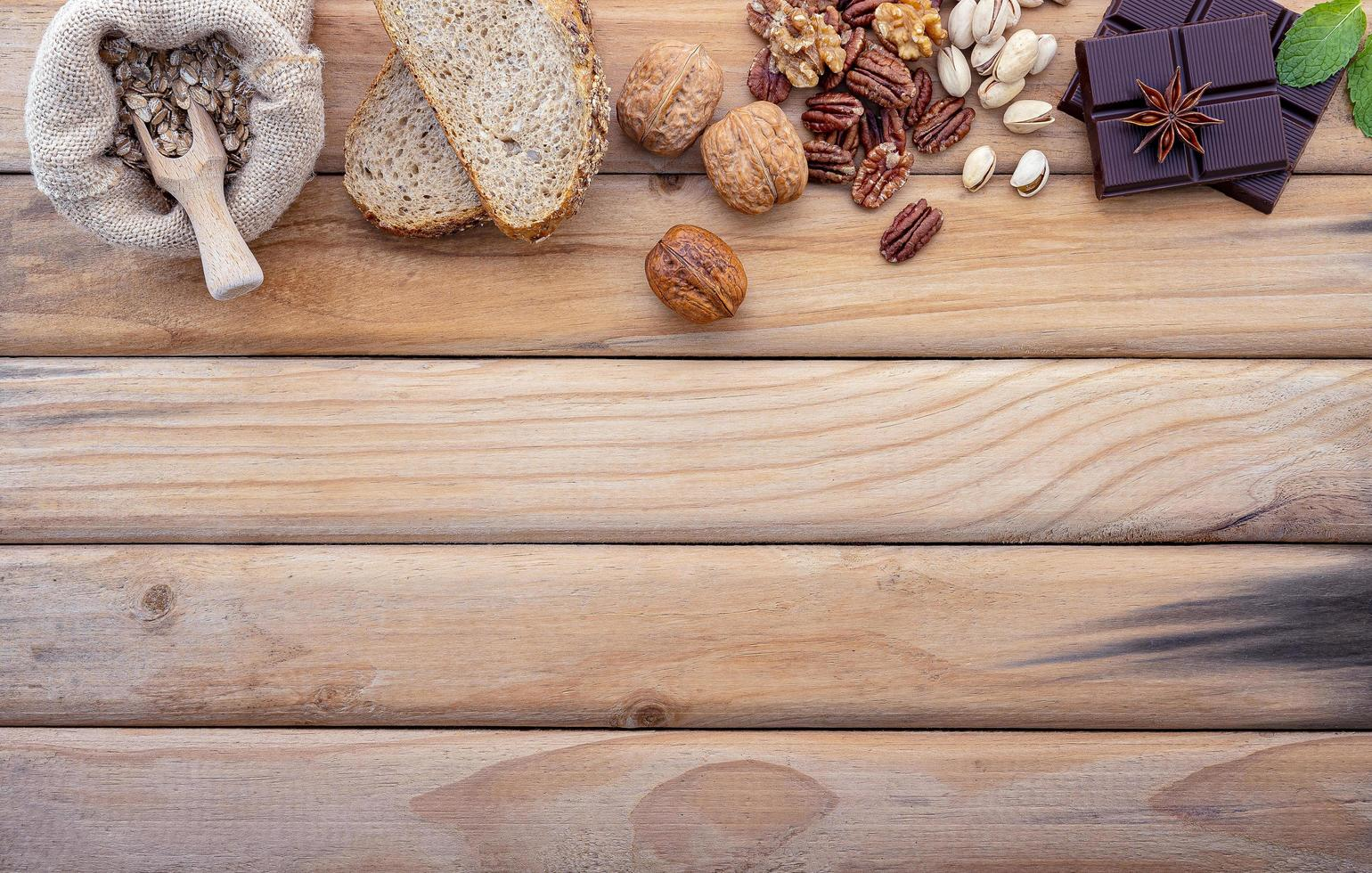 Fresh ingredient border on wood with copy space photo