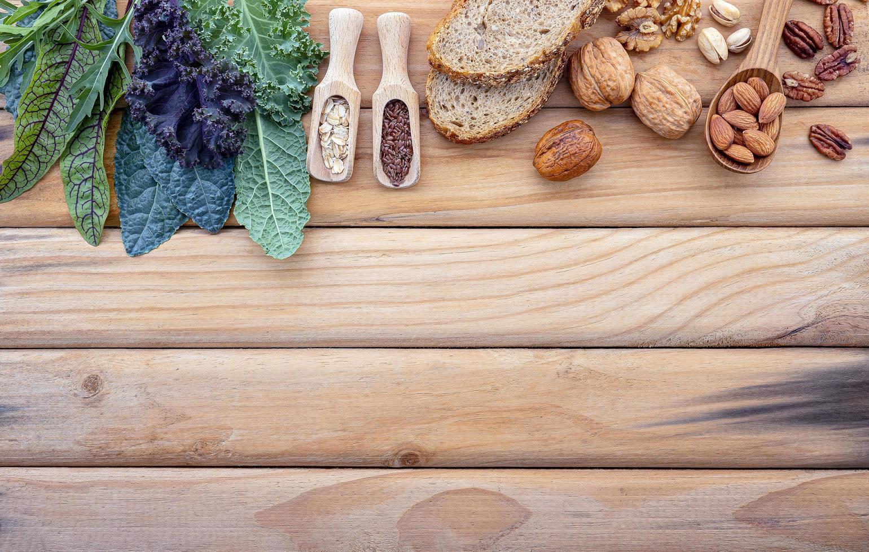 Fresh ingredient border on wood photo