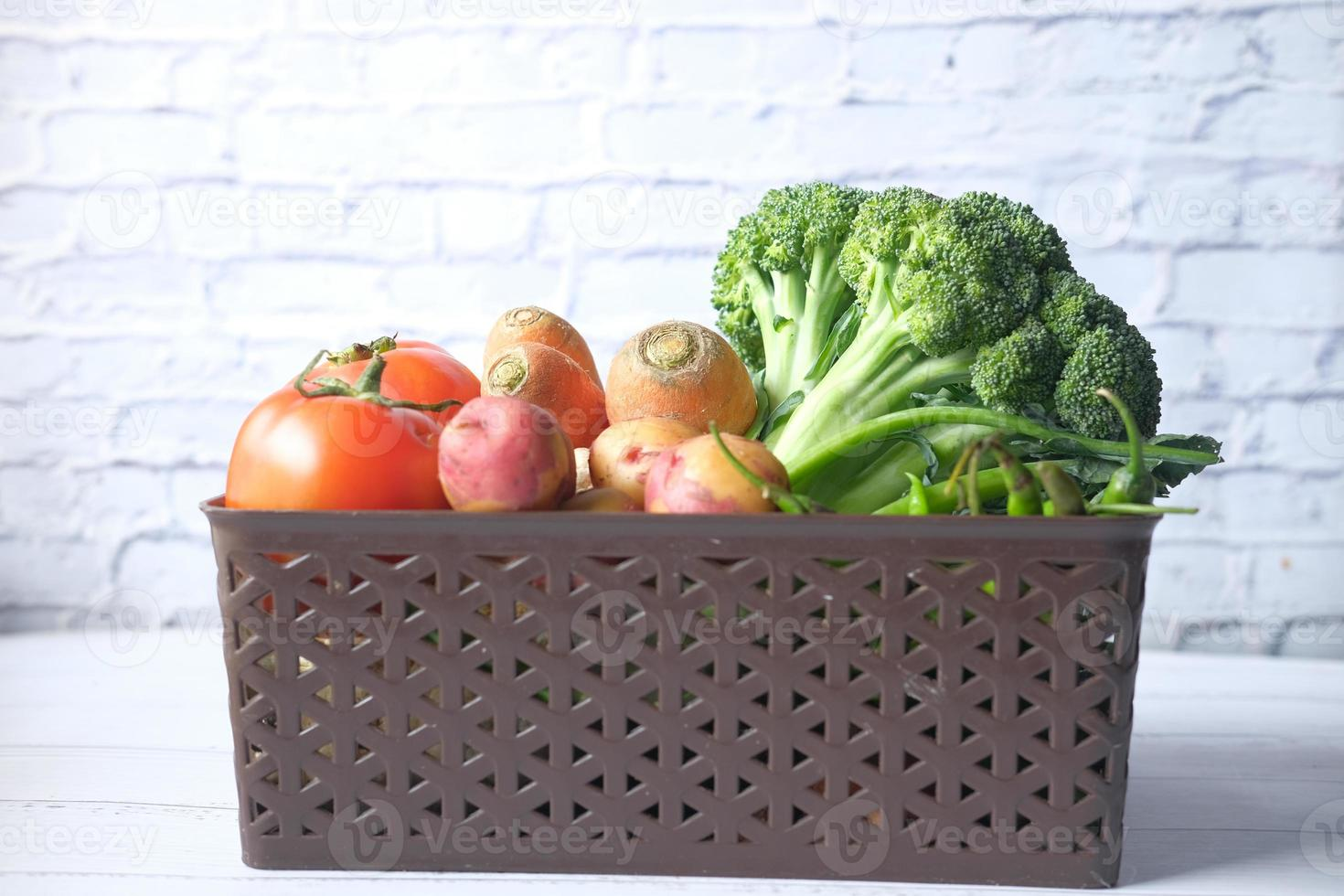 Healthy food selection with fresh vegetables in a bowl on table photo