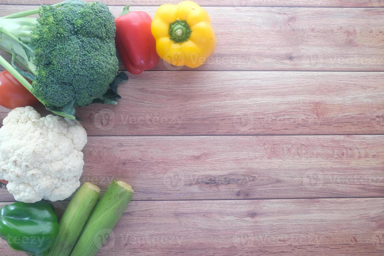 Healthy food selection with fresh vegetables on table with copy space photo
