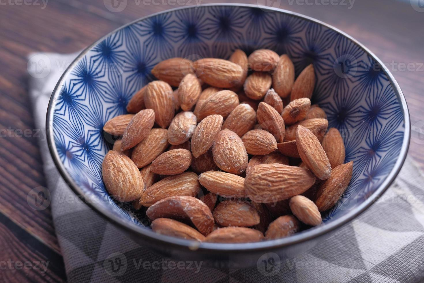 Close-up of almond nuts in a bowl photo