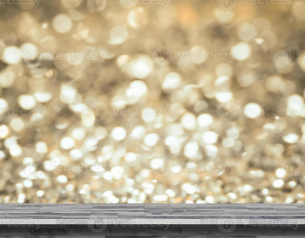 Estante de mármol gris con fondo dorado bokeh foto