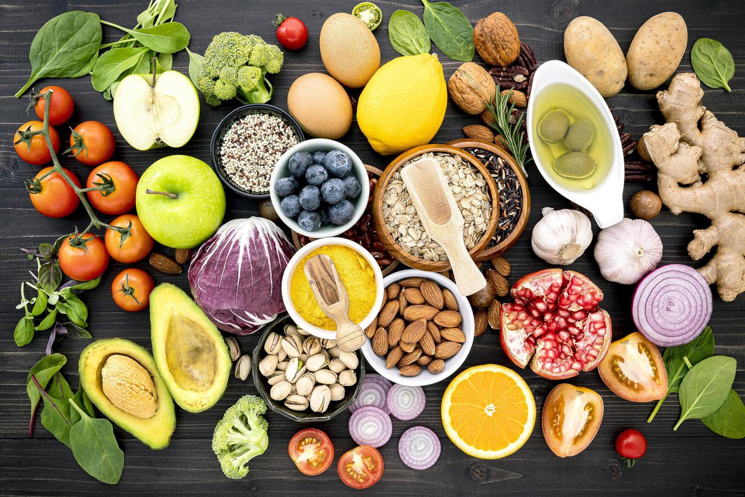 Top view of healthy foods on a dark background photo