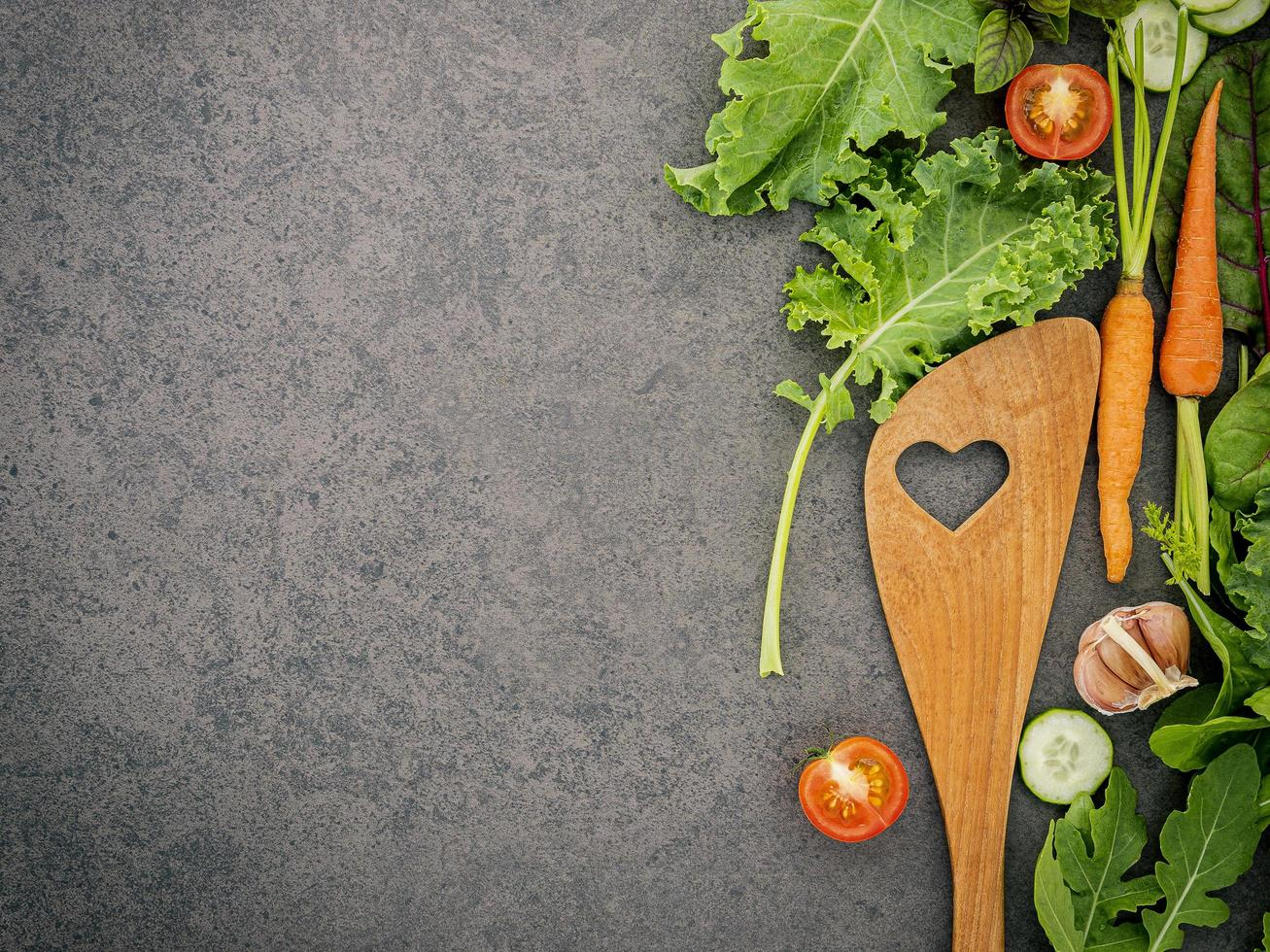 Veggies and a wooden utensil with copy space photo