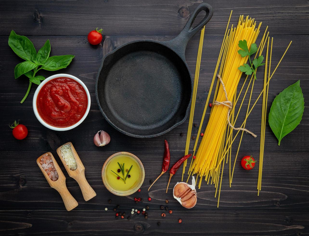 Cast iron skill and spaghetti ingredients photo