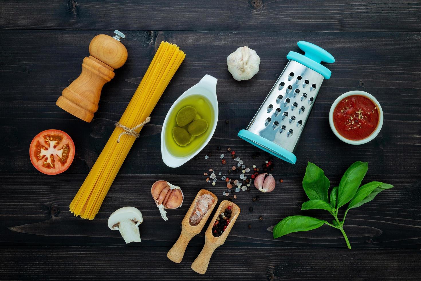 Pasta ingredients on dark wood photo