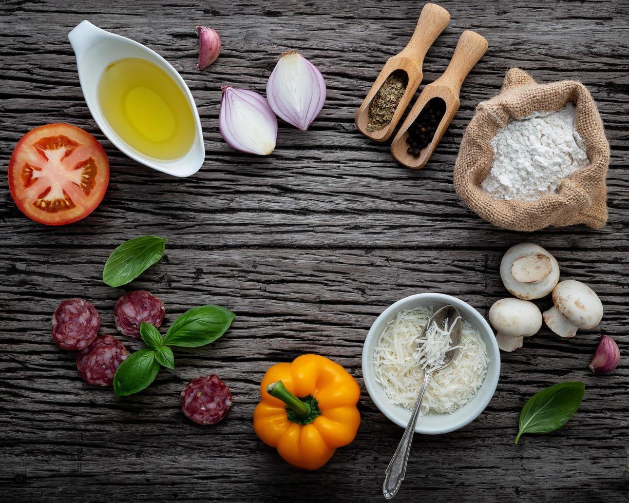 Fresh pizza ingredients on wood photo
