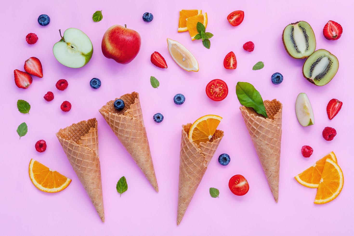 Colorful fruit and ice cream cones photo