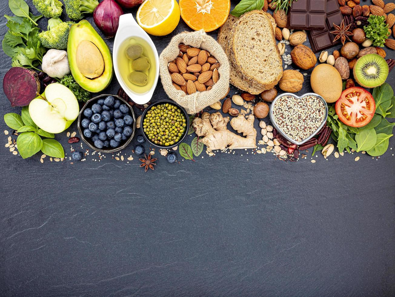 Healthy foods with copy space on dark slate photo