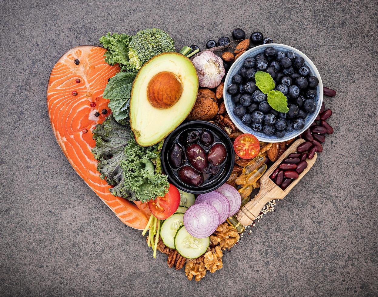 Healthy foods in a heart shape on slate photo