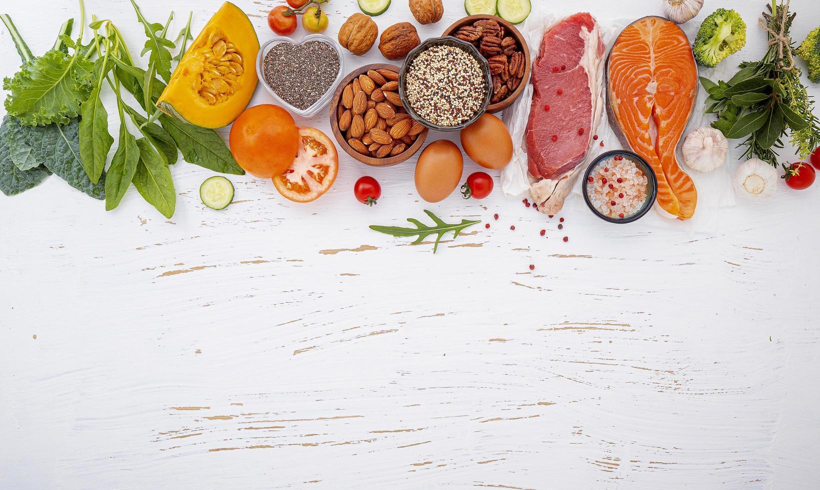 Fresh healthy ingredients on shabby white background photo