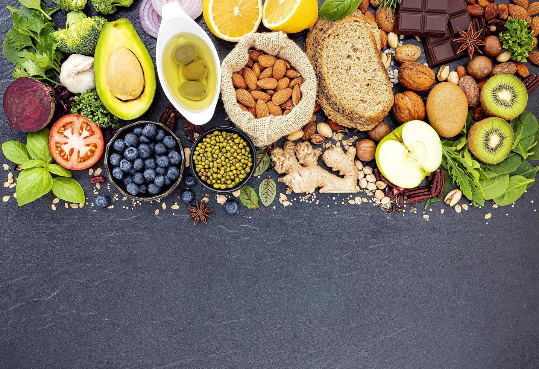 Healthy foods flat lay on dark slate photo