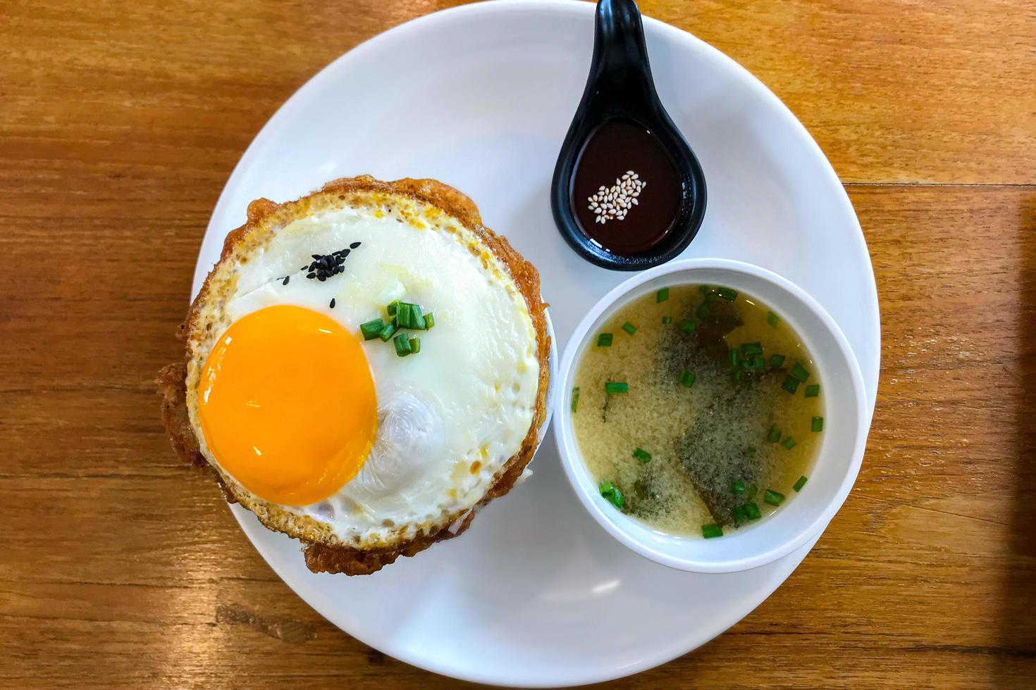 Kimchi fried rice with fried egg and pork photo