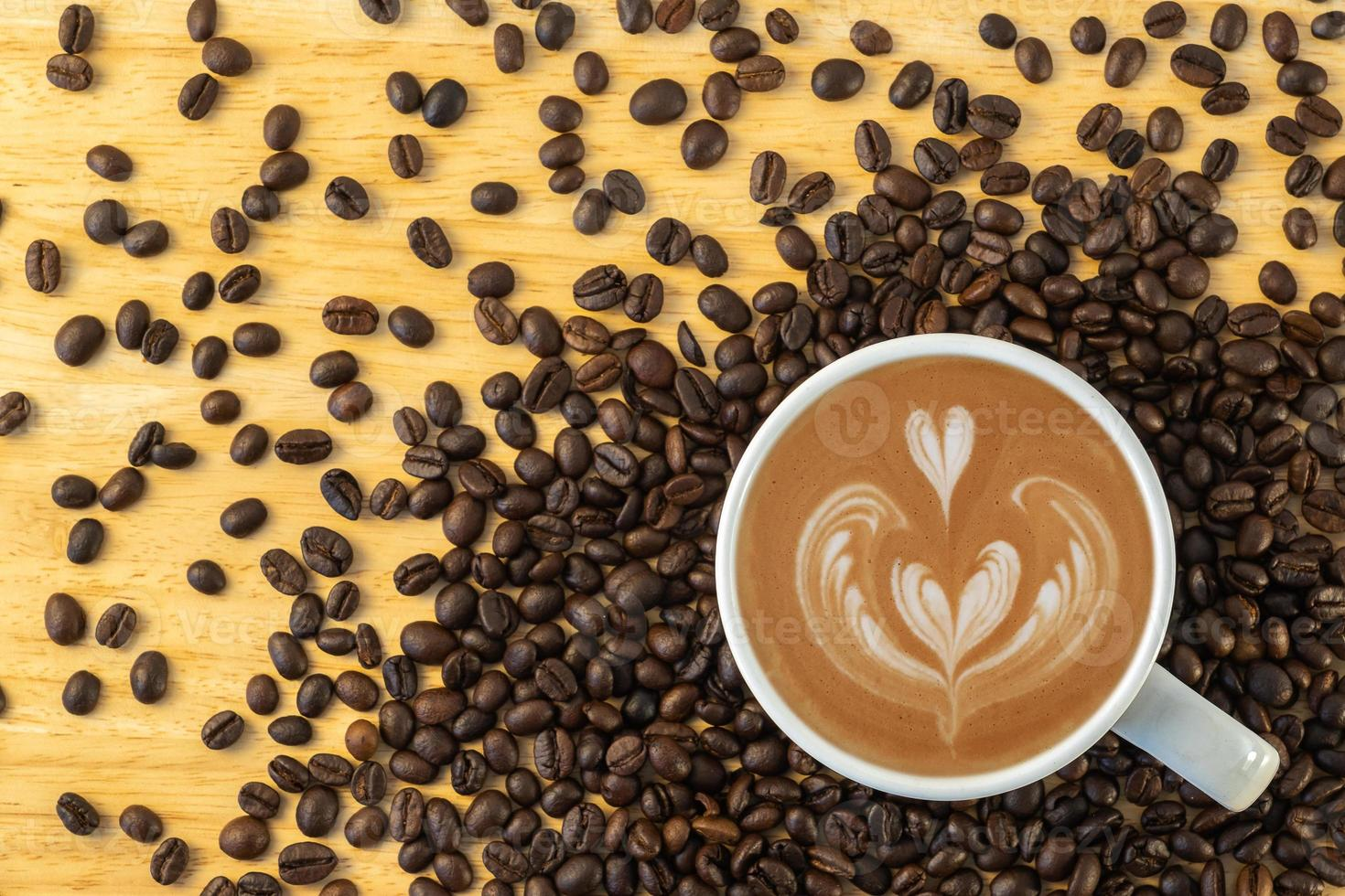 Top view of a mug of coffee with beans photo