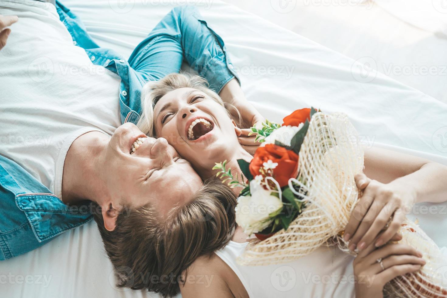 Happy couple together in the bedroom photo