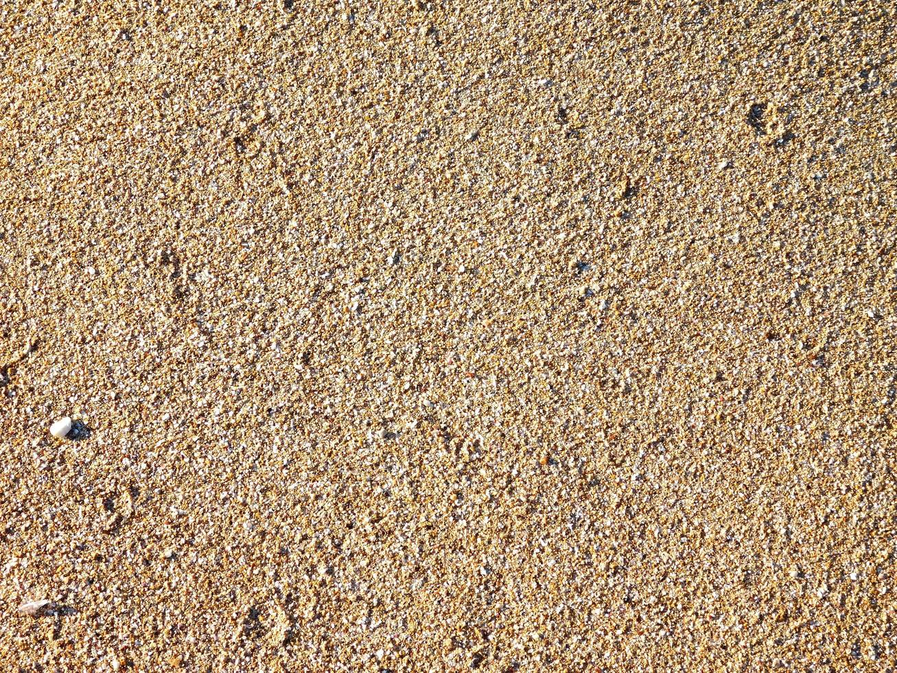 Patch of sand for background or texture photo