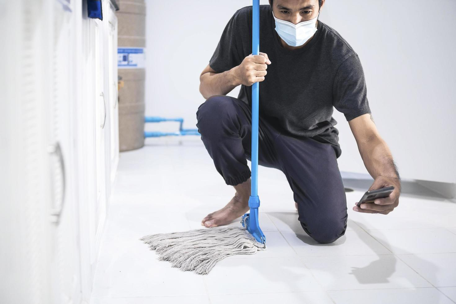 Asian man mopping the floor photo