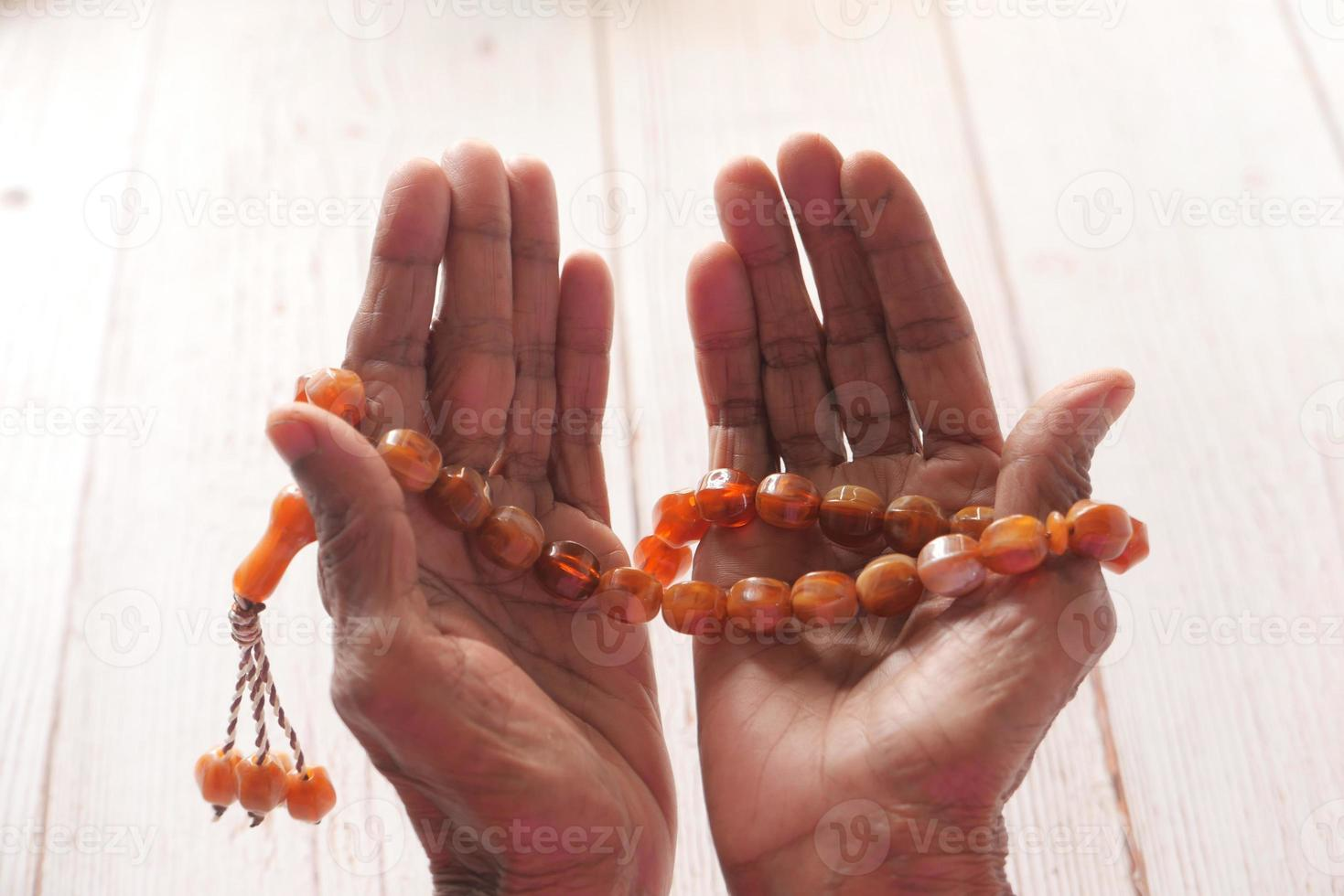 Prayer beads in an old man's hand photo
