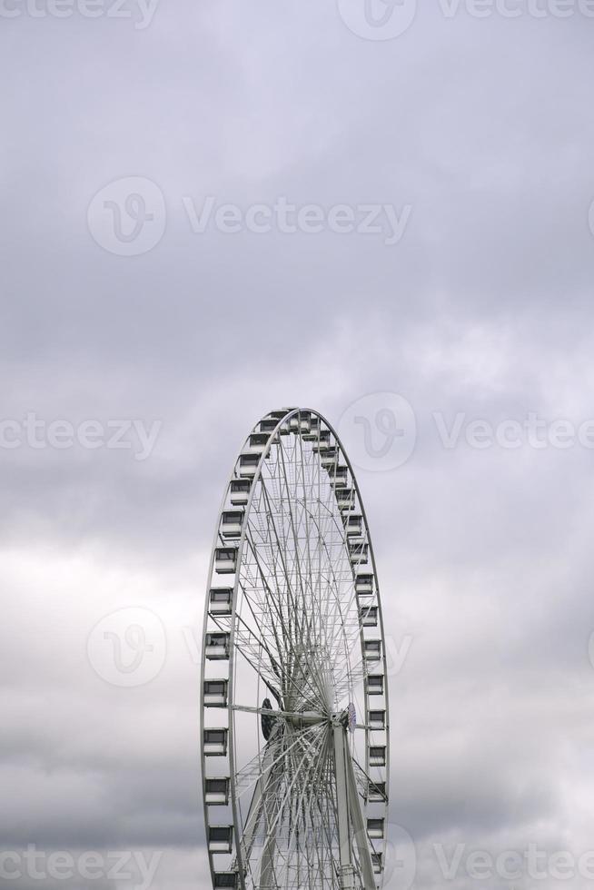 Ferris wheel under cloudy sky photo