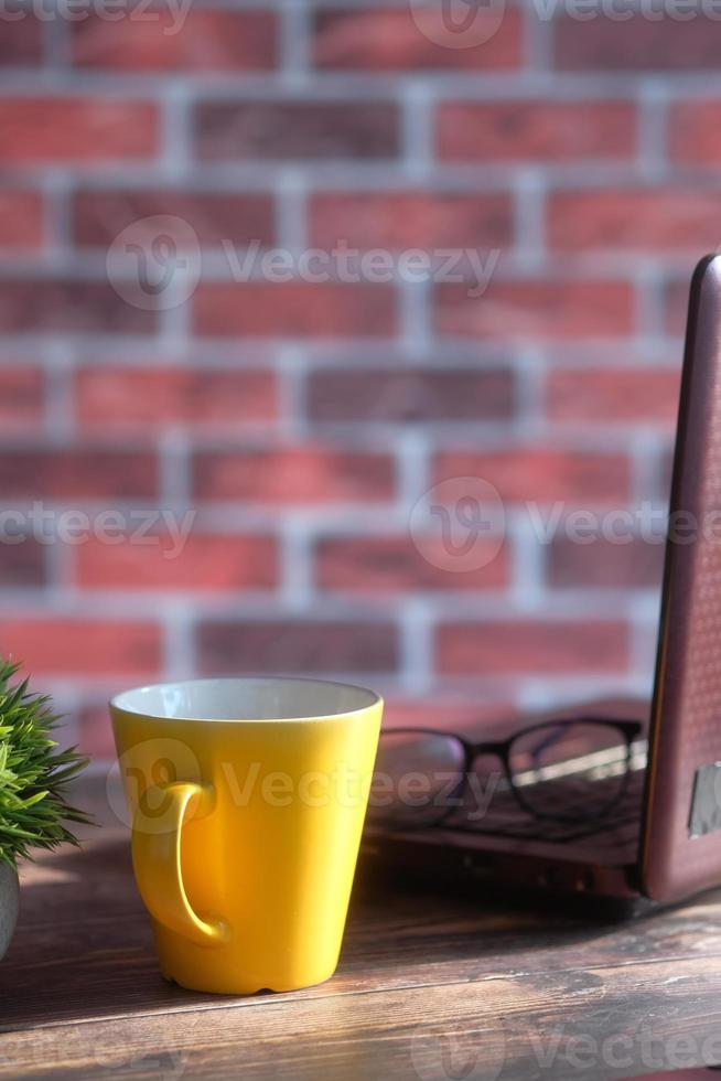 Yellow mug on a desktop photo