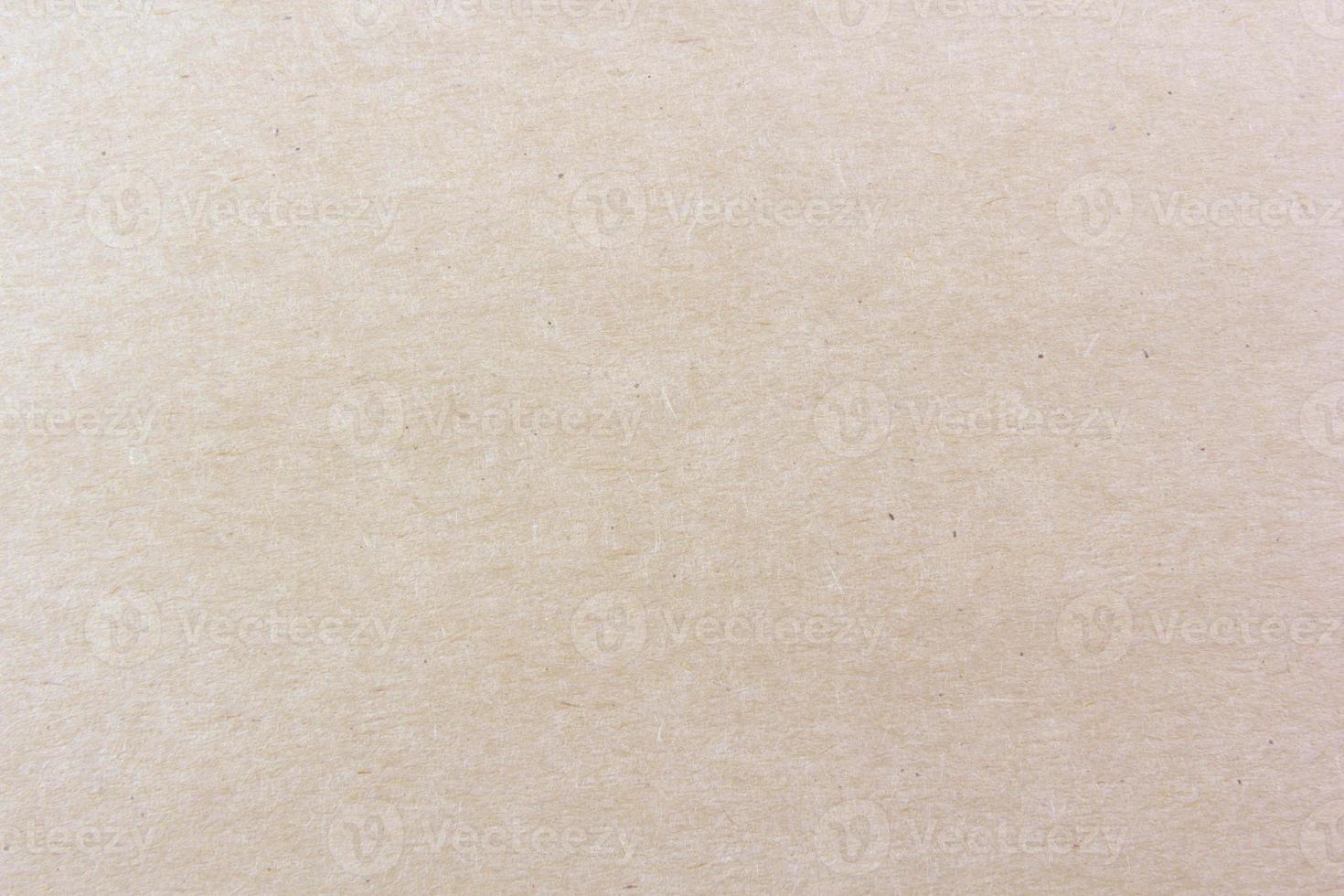 Primer plano del patrón de textura de papel marrón claro para el fondo foto
