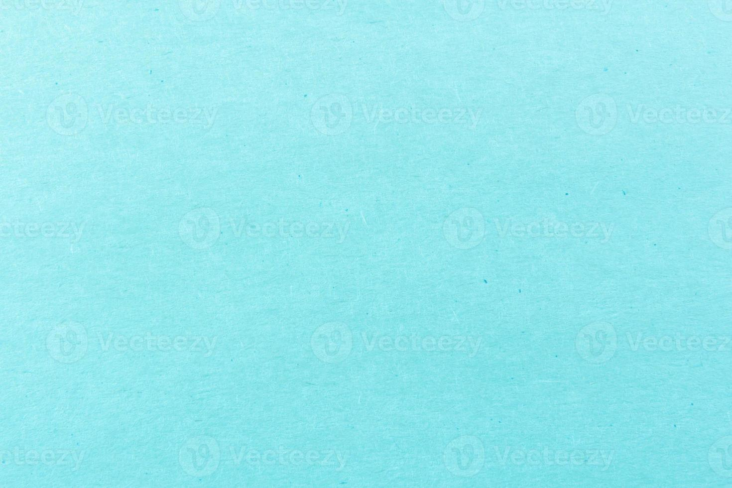 Close-up shot of light blue paper texture pattern for background photo