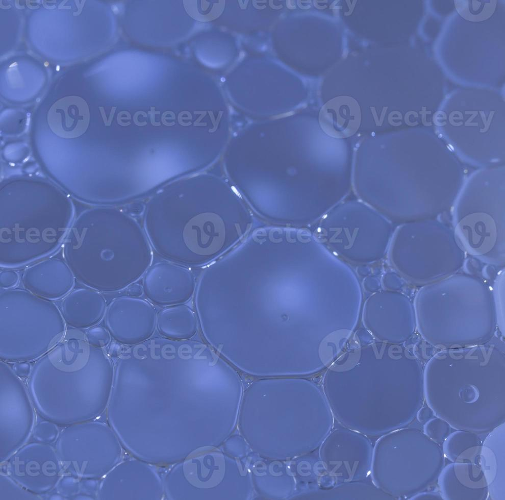 Macro shot of olive oil mixed in water photo