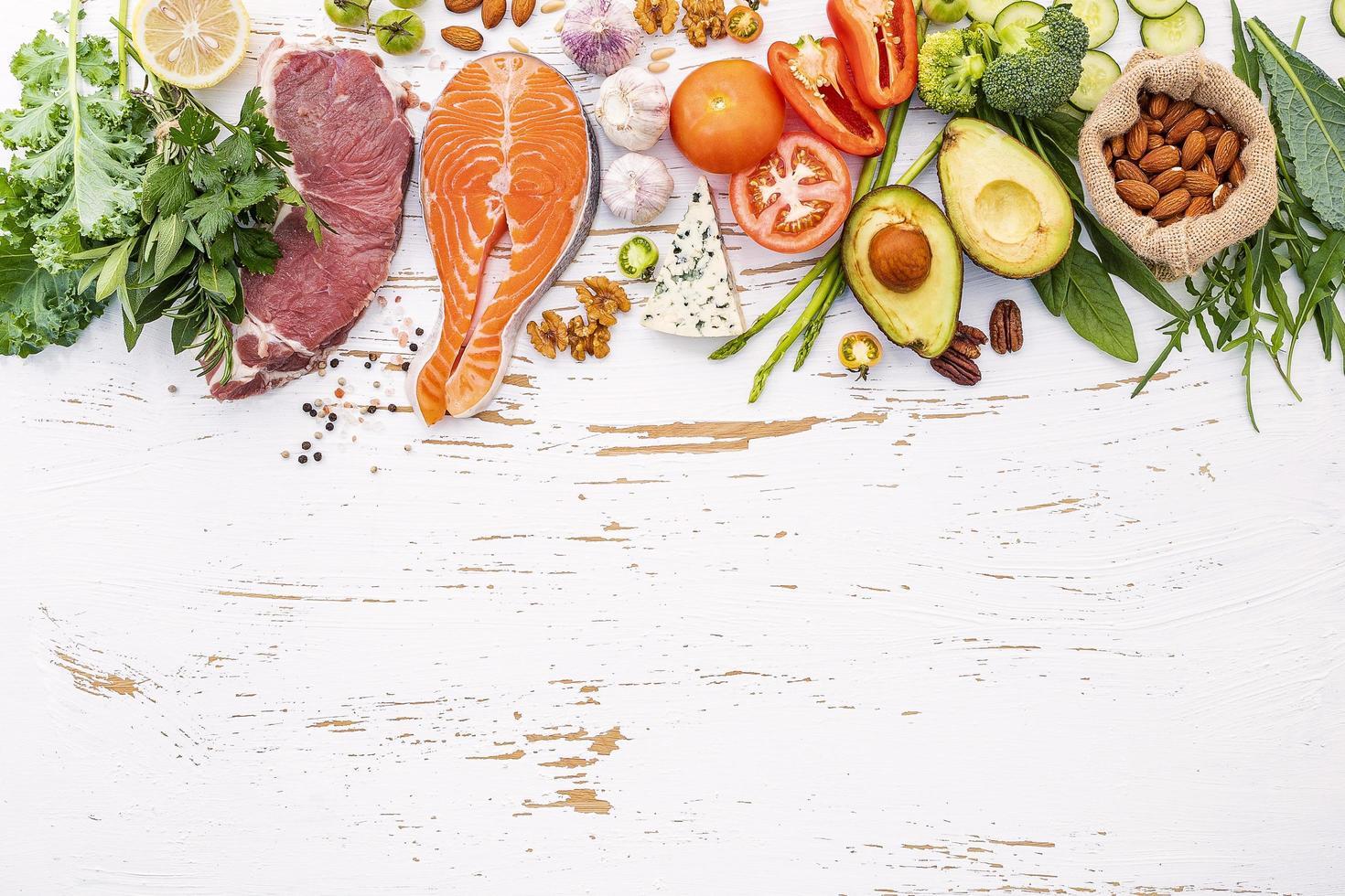 Organic ingredients on shabby white background photo