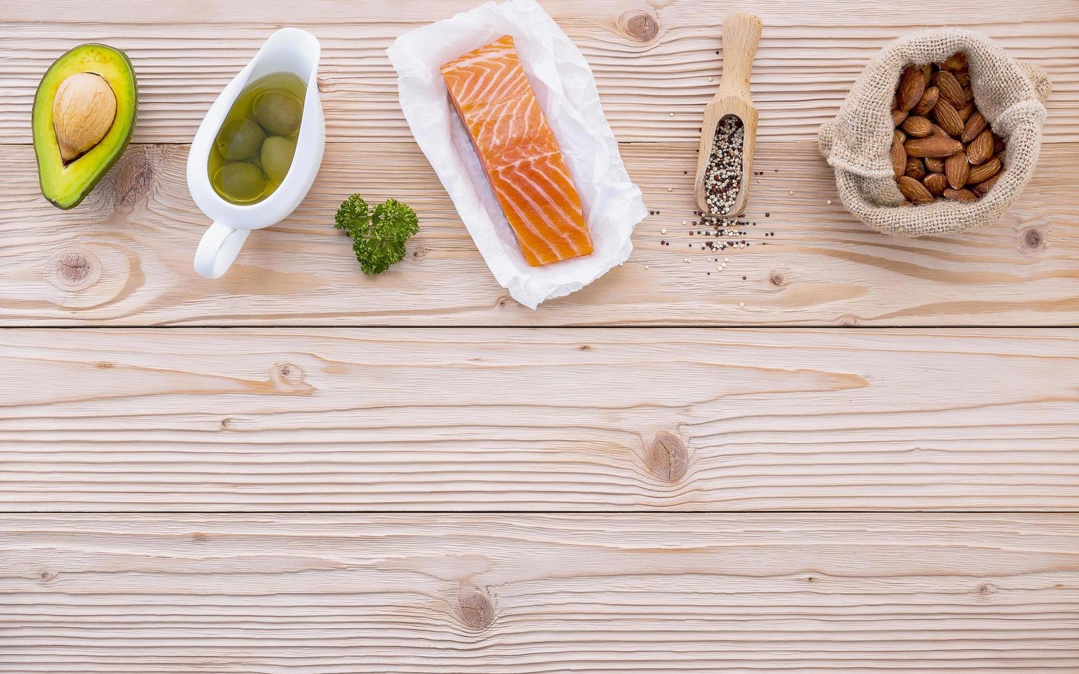 Healthy food items on light wood photo