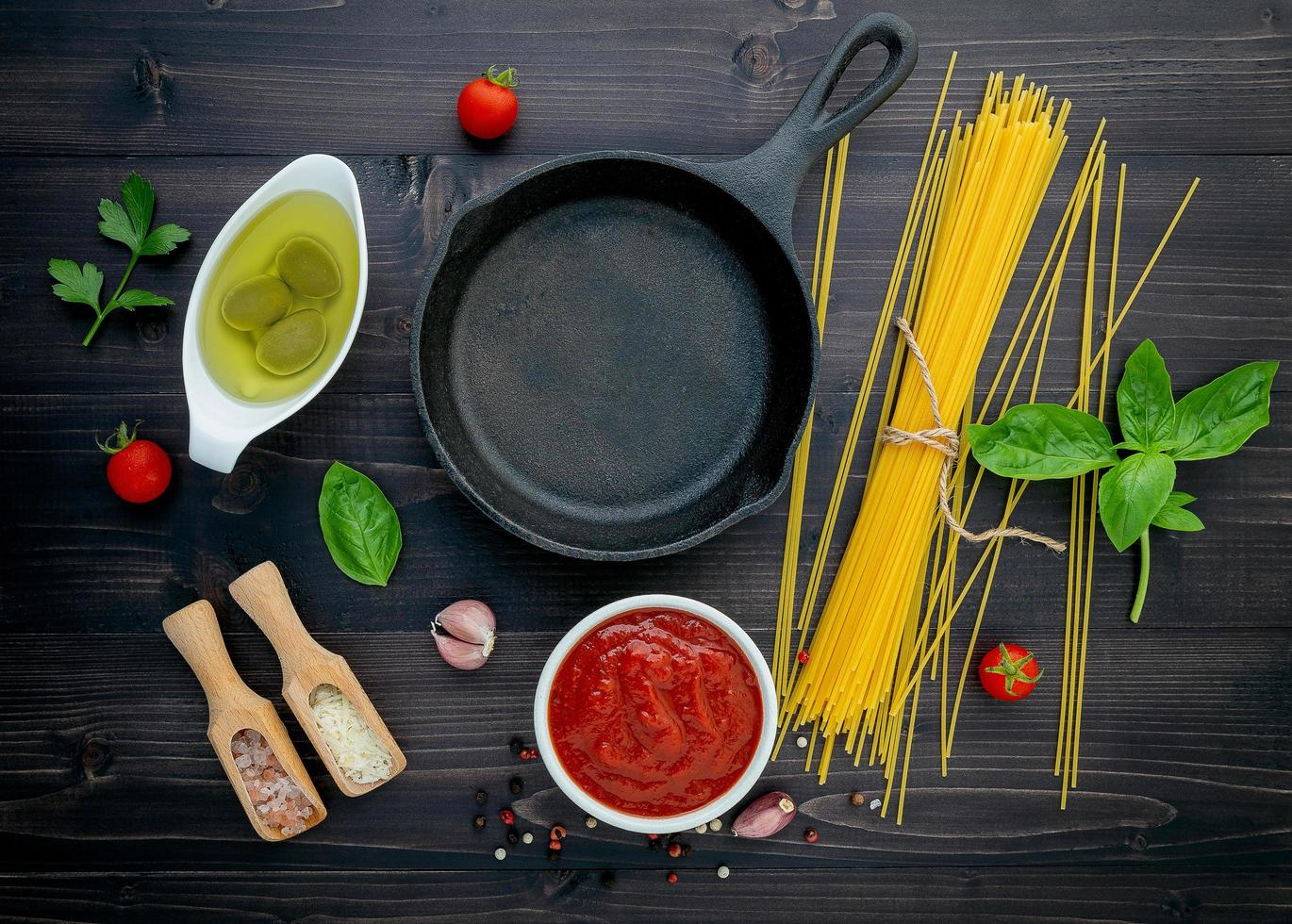 Frying pan with spaghetti ingredients photo