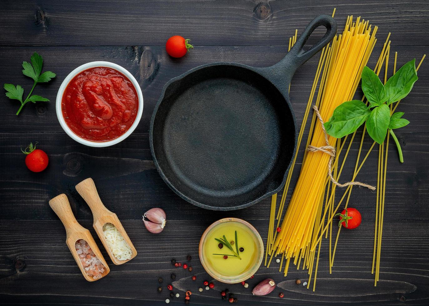 Frying pan and fresh spaghetti ingredients photo