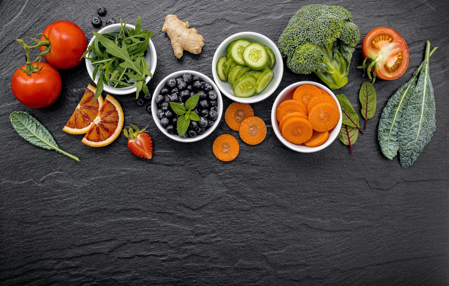 Bowls of fruit and vegetables photo