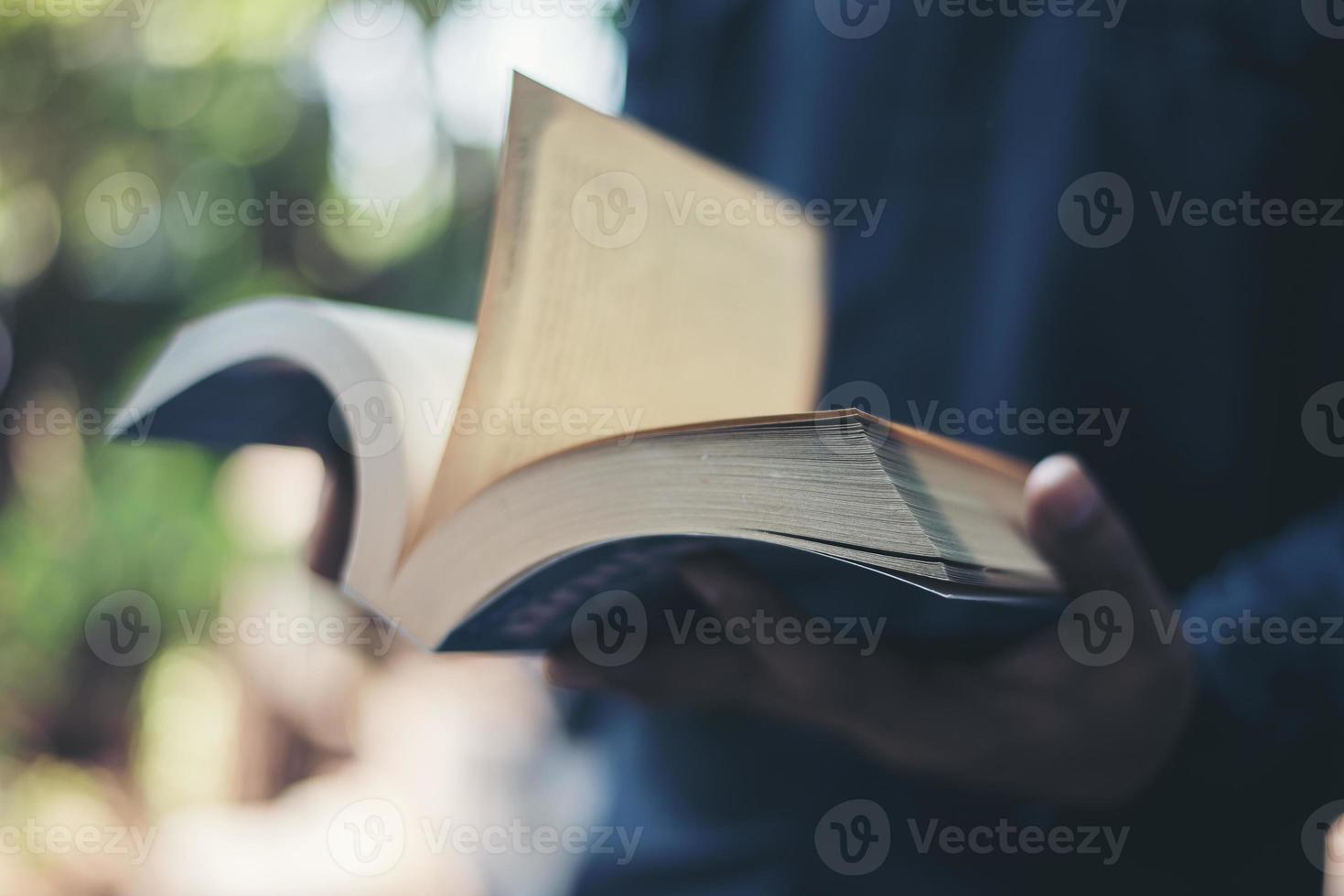 Close-up of woman's hands holding a book reading photo